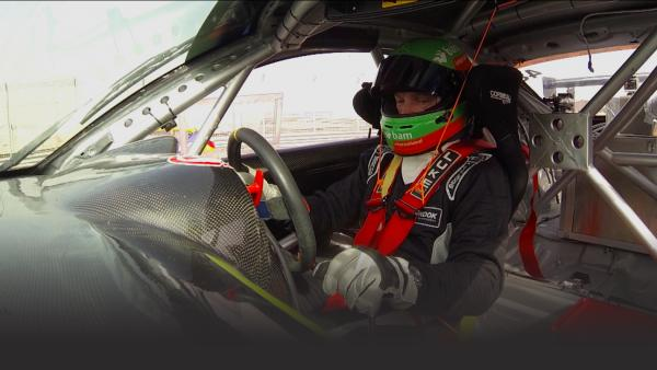 Race car driver behind the wheel