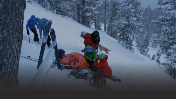 Rescuers tend to injured skier
