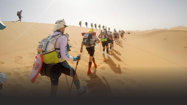 Racers walking in desert