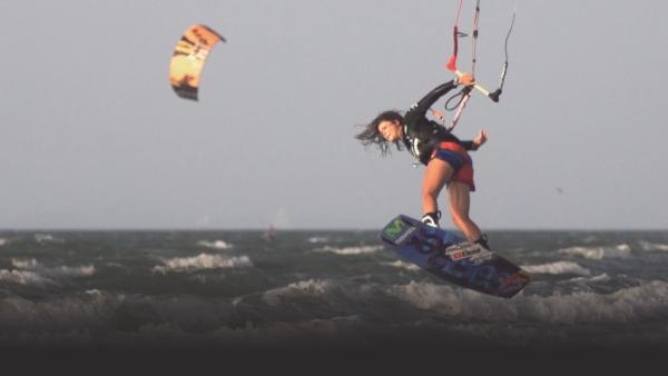 Woman kitesurfing