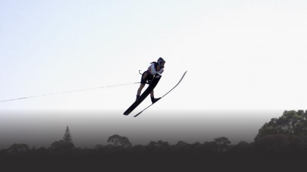Woman waterski jumping