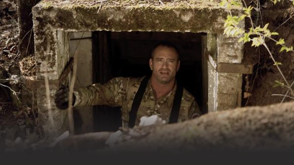Man in bunker doorway