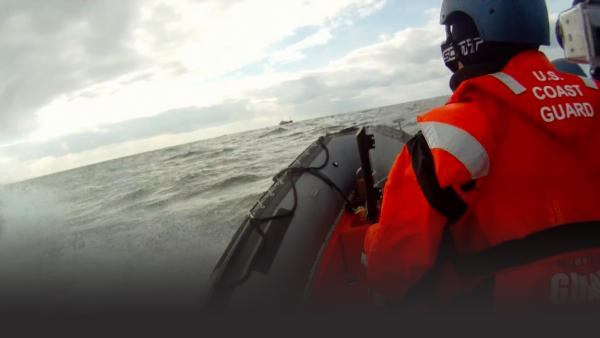 Coast Guard man in an inflatable boat