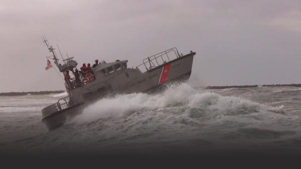 Coast Guard cutter on huge wave