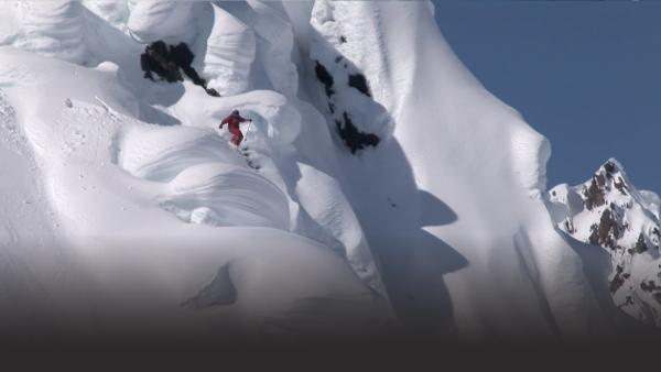 Man skiing down vertical drop