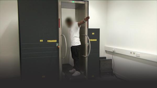 A full body scan to see if the man is smuggling drugs