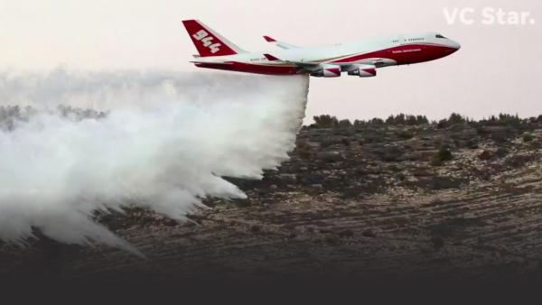 Firefighting plane drops water from the air