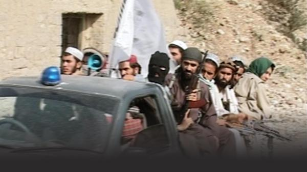 Taliban members packed into the back of a truck