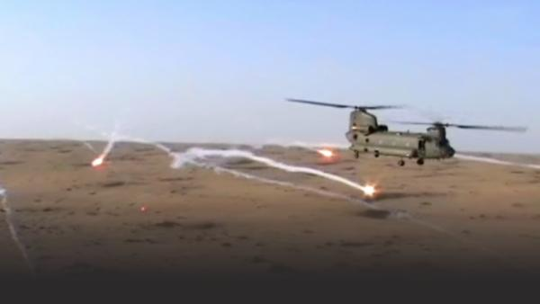British military helicopter firing missiles in Afghanistan