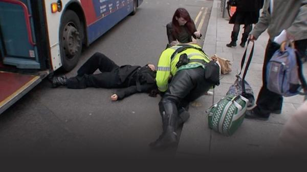 Paramedics on scene caring for a woman who was hit by a bus