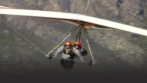 People hang gliding