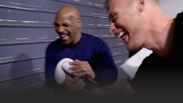 Freddie Flintoff and Mike Tyson laughing and shaking hands
