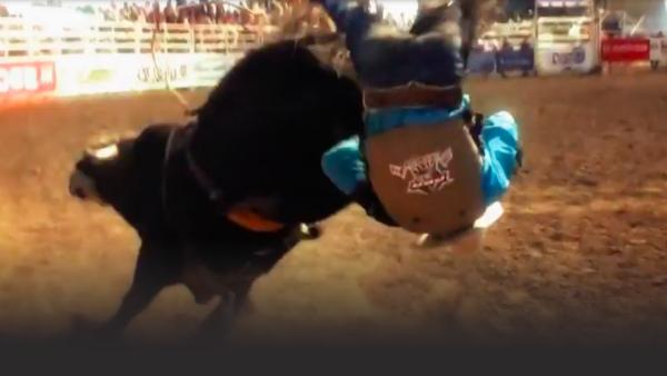 Bull rider flips out
