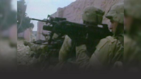 American soldiers with machine guns in Iraq