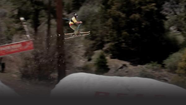 Skier jumping off a rail