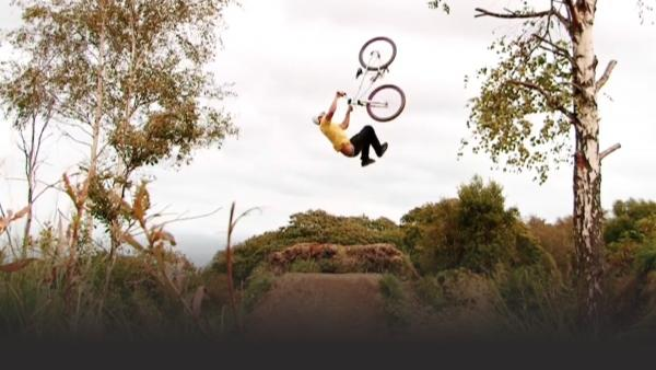 Man motocross flipping off a jump