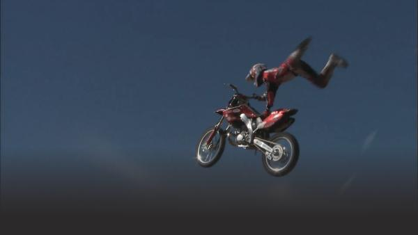 Dave Demangos soaring through the air as he performs his superman stunt