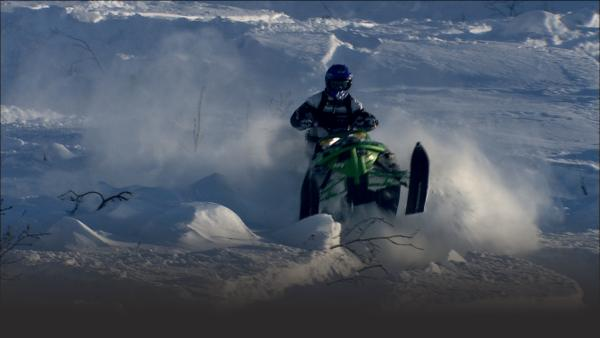 Snowmobiler races down mountain