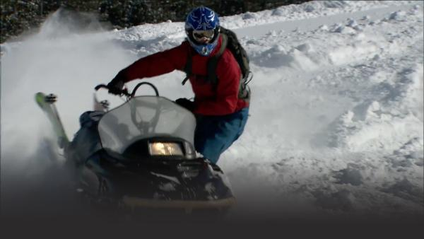Pro Snowmobiler rides his way down the steep slopes Montana has to offer.