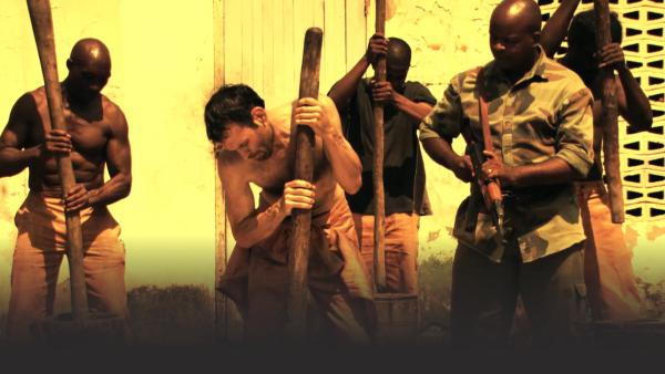 Man working in Gambian prison camp