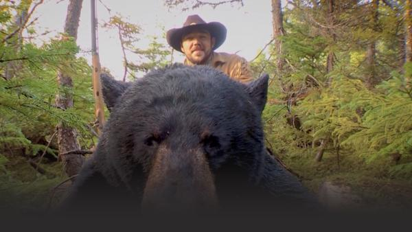 Man posing with bear