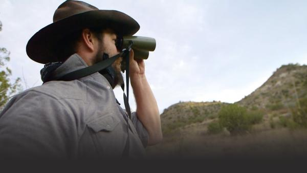 Man looking into binoculars