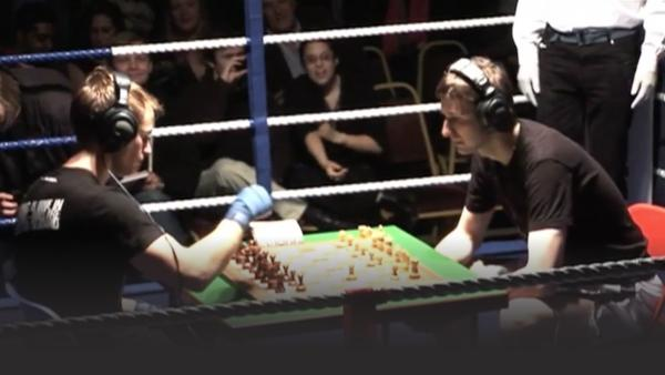 Two men competing in Chessboxing