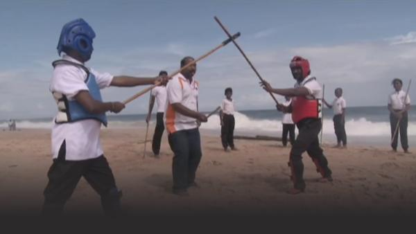 Silambam stick fighting on the beach