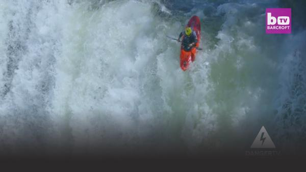 Kayaker goes over waterfall