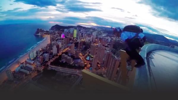 BASE Jumper pushes off building
