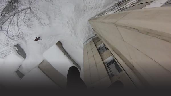 Dude Jumps off Building Into Pile of Snow