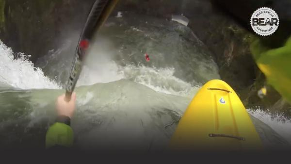 Kayaker goes over a waterfall