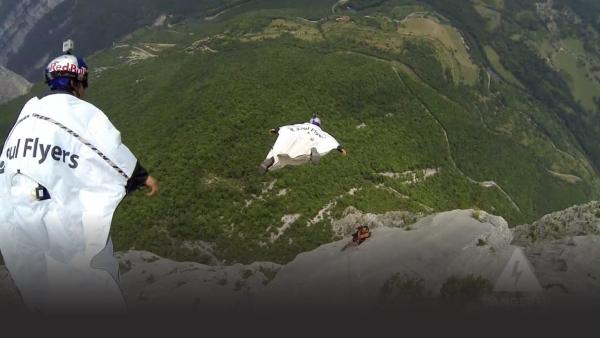 Wingsuiters jump off mountain