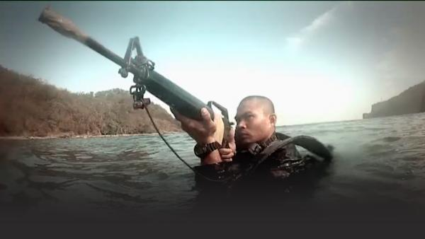 Soldier in the water with a rifle