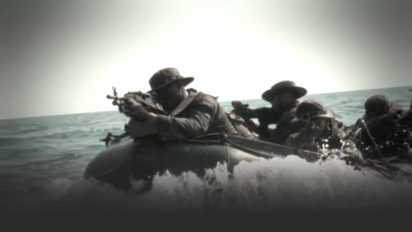 Thai marines with guns on small boats in the ocean