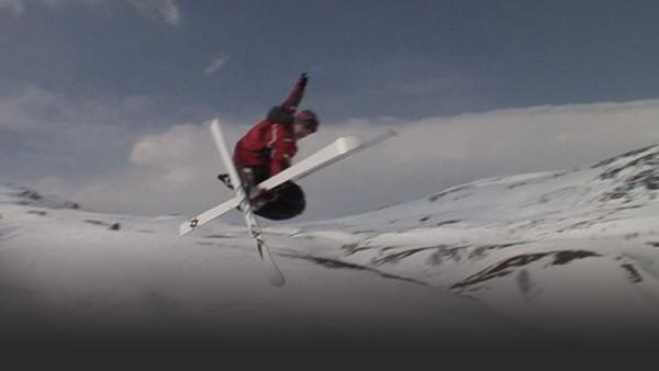 Man doing a trick with his skis