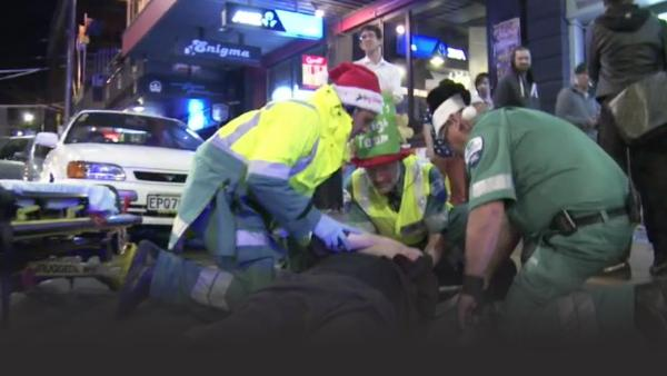 Ambulance crew help drunk partiers during Christmas time