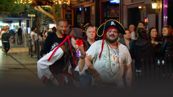 Partyers wearing pirate costumes