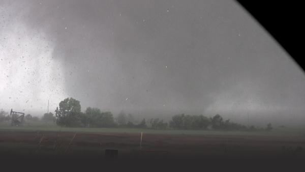 A mile-wide tornado seen from the tornado chaser vehicle