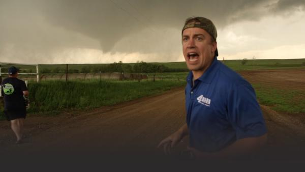 Man yelling with tornado in background