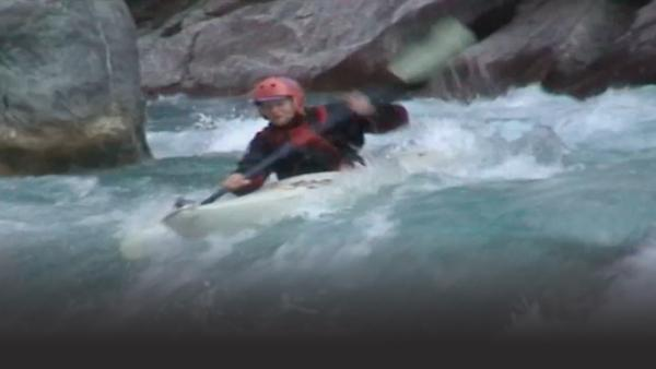 Guy Baker kayaking serious rapids.