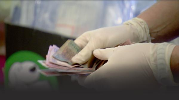 Police officer counting money