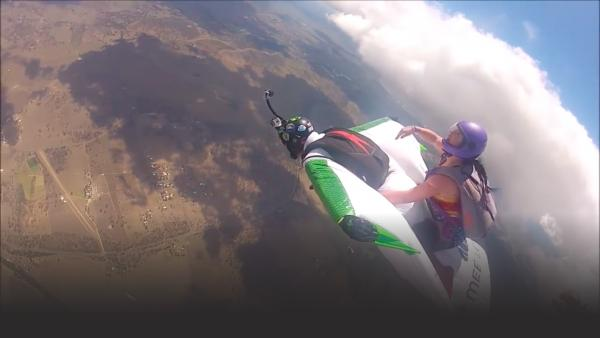 Girls hitchhike on wingsuit flyers