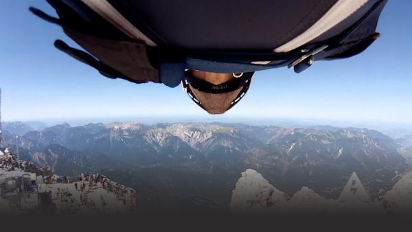 Man in wingsuit in mountains